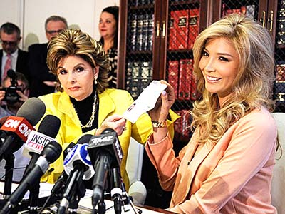 Gloria Allred and Jenna Talackova hold up her passport at a press conference