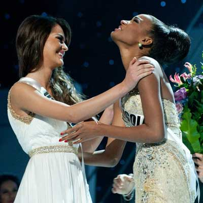 Angola's Leila Lopes reacts to winning Miss Universe 2011