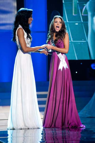 Maryland`s Nana Meriwether looks on as Rhode Island`s Olivia Culpo reacts to winning Miss USA 2012