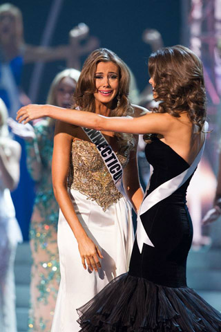 Erin Brady reacts to being named Miss USA 2013 and is congratulated by 1st runner up, Alabama's Mary Margaret McCord