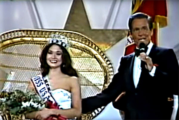 Miss USA 1984 (New Mexico's Mai Shanley) sits in her throne shortly after host Bob Barker announces her win