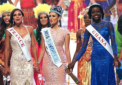 Philippines' Megan Young after being crowned Miss World 2013 stands between her two runners-up from France and Ghana
